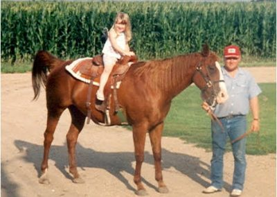 Tiffany riding Belle with Father Gary in Nebraska